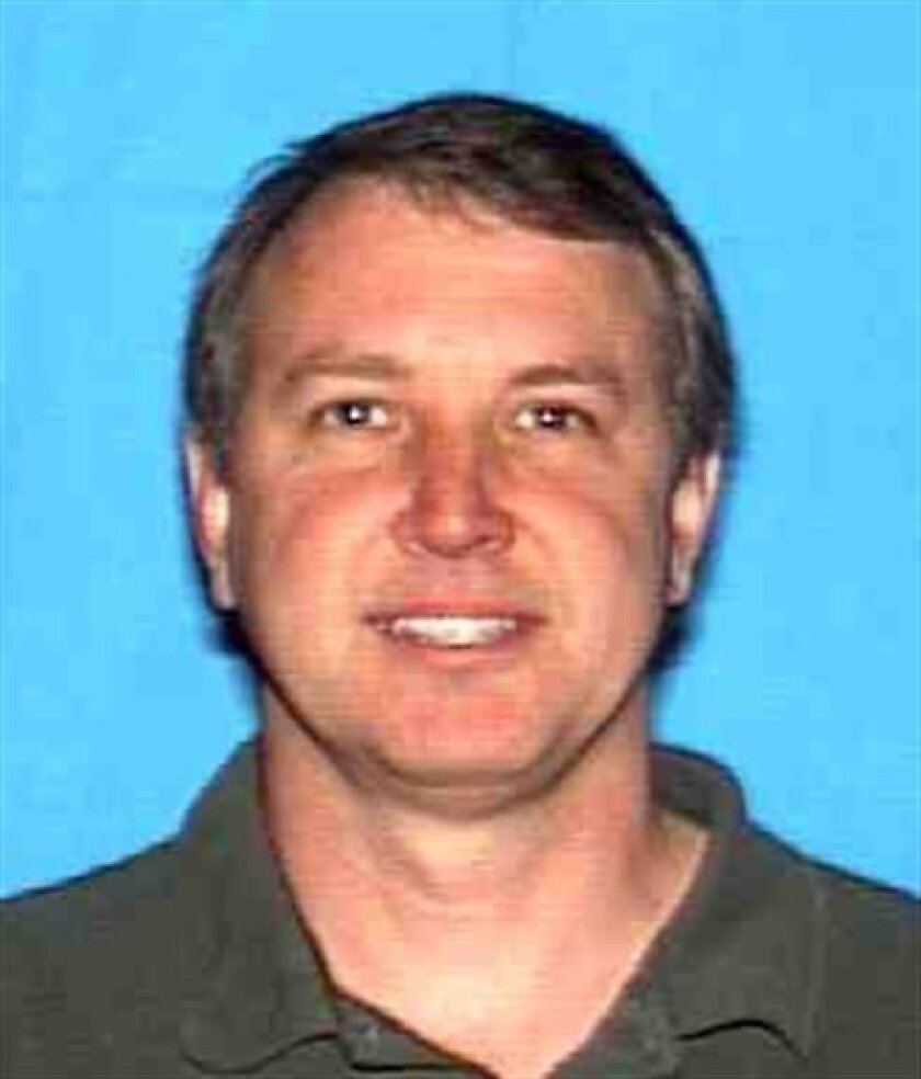 This image provided by the California Department of Motor Vehicles shows Thomas Fuchs, 49, who fatally shot his two teenage sons, set their Chula Vista home on fire and then shot himself, June 21, 2011 in Chula Vista, Calif. Police and mental health experts say there is no logical explanation for what prompts a father or mother to resort to such desperate and ugly acts. (AP Photos/Calif. DMV)