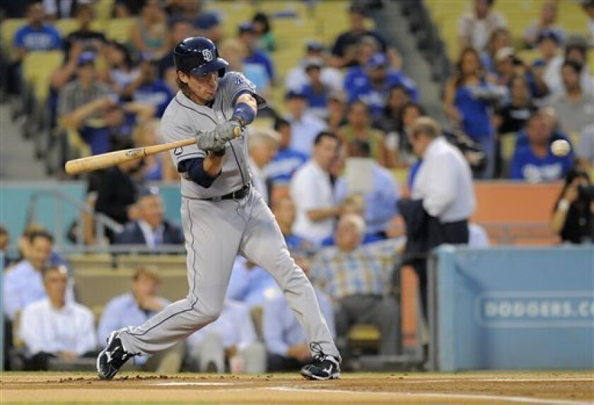 San Diego Padres' Chris Denorfia hits the first pitch of the game for a solo home run during the first inning of their baseball game against the Los Angeles Dodgers, Tuesday, Sept. 4, 2012, in Los Angeles. (AP Photo/Mark J. Terrill)