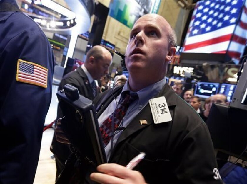 FILE - In this Wednesday, Oct. 2, 2013 file photo, trader Kevin Walsh works on the floor of the New York Stock Exchange. Stock futures were rebounding before the opening bell Friday, Oct. 4, from a significant sell-off over the past two days, but major averages that have been rattled by the partial