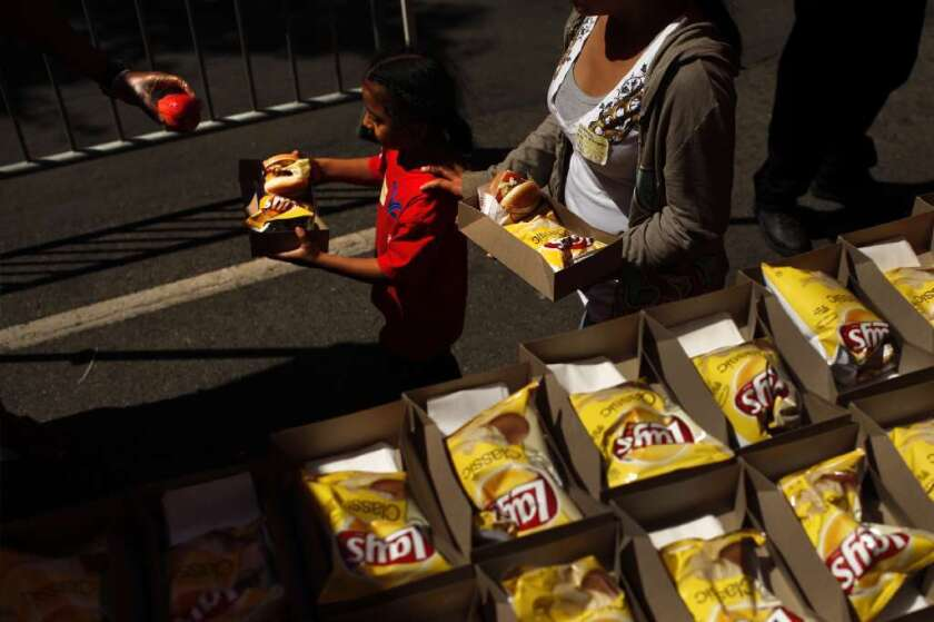 A new report says childhood poverty is at its highest level in 20 years. This girl receives a free lunch from the Los Angeles Mission.