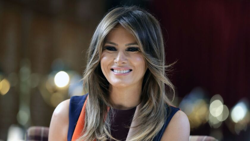 FILE - In this July 13, 2018, file photo, first lady Melania Trump takes a seat during a visit to Th