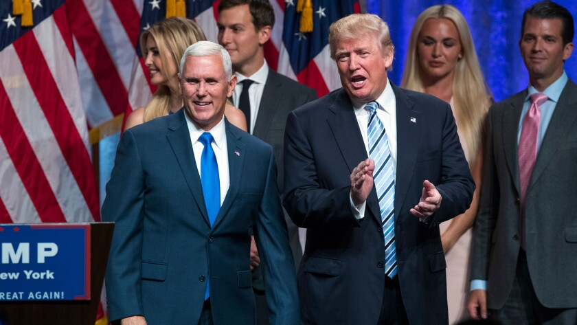 Donald Trump applauds after introducing Indiana Gov. Mike Pence at their first joint appearance as the Republican presidential ticket.