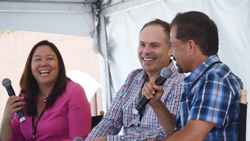 Jen Leo, John DiScala (Johnny Jet), center, and Gabe Saglie of Travelzoo talk about how to save money on travel at the Los Angeles Times Festival of Books on Saturday.