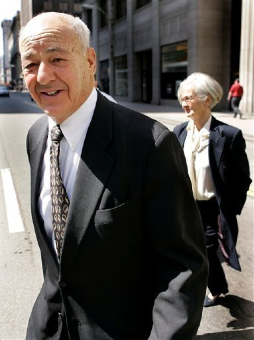 FILE -  In this April 8, 2008 file photo, Dr. Cyril Wecht leaves his attorney's downtown Pittsburgh office with his wife Sigrid, right. The criminal case against  Wecht is over. Federal prosecutors say all remaining counts will be dropped, Tuesday June 2, 2009. (AP Photo/Gene J. Puskar, File)