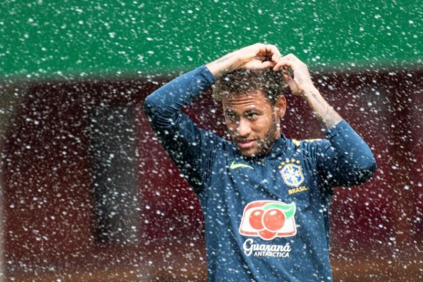 Brazilian national soccer team player Neymar reacts during his team's training session in Vienna, Austria, 09 June 2018. The Brazilian national soccer team will face Austria in an International Friendly soccer match on 10 June 2018. EFE