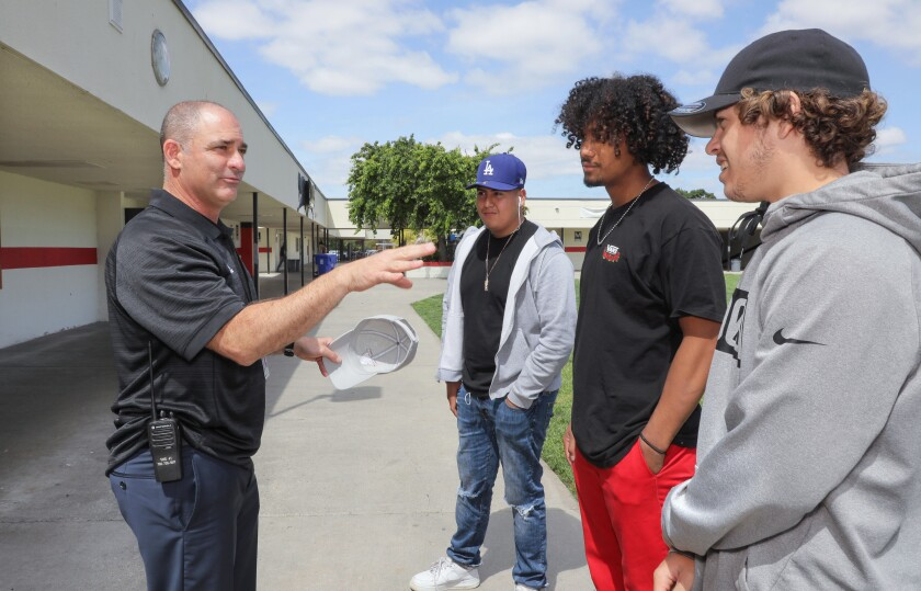 Incoming Vista High School Principal David Jaffe introduces himself to some students at the school, LtoR: Herminio Bahena, Michael Leama, and Tristan Gonzalez.