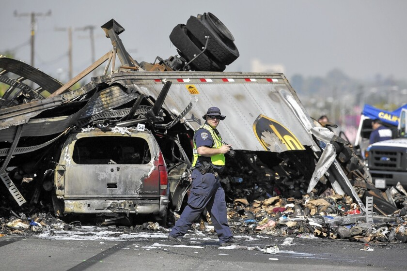 California Highway Patrol investigators at the scene of a fiery crash Feb. 27 on the 5 Freeway in the City of Commerce.