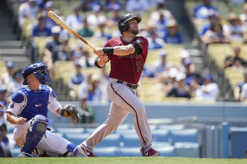 Arizona Diamondbacks' Stephen Vogt (21) hits a home run during the fourth inning of a baseball game against the Los Angeles Dodgers Sunday, July 11, 2021, in Los Angeles. (AP Photo/Ashley Landis)