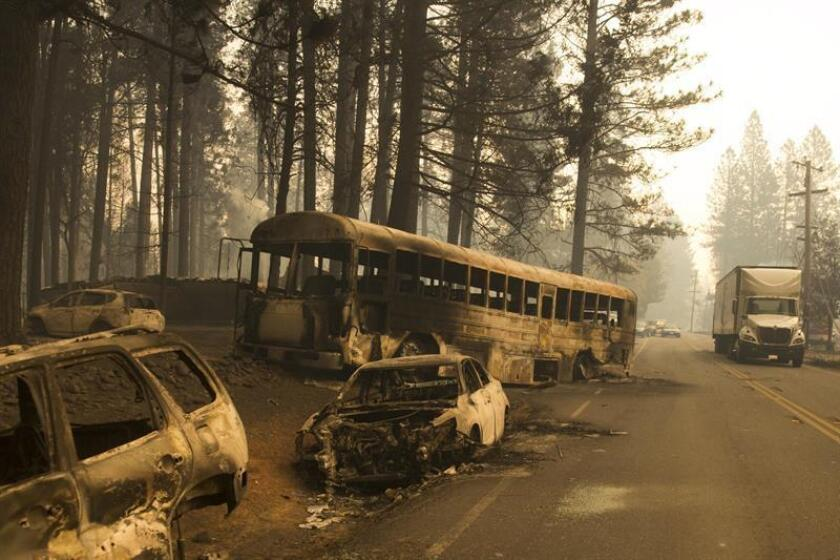 Abandoned cars from fleeing residents of the Magalia and Paradise Pine area, line Skyway road the day after the start of the Camp Fire that continues to burn out of control through the region, fueled by high winds in Butte County, California, USA. EFE/EPA/File