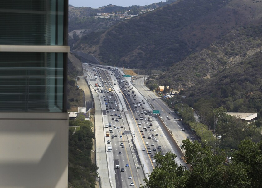 L.A. and county officials celebrated the opening of the new northbound carpool lane on the 405 Freeway through the Sepulveda Pass.