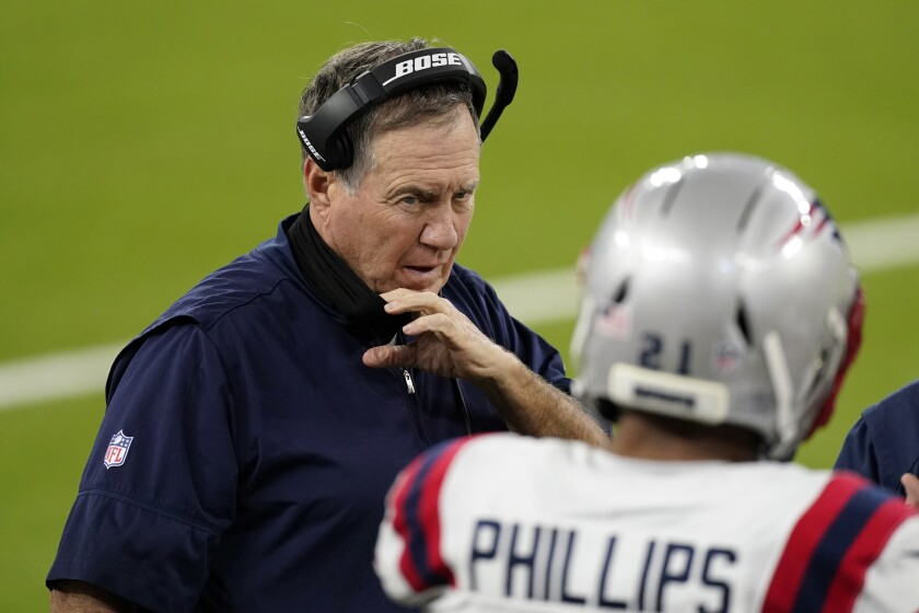 New England Patriots head coach Bill Belichick talks to Adrian Phillips.