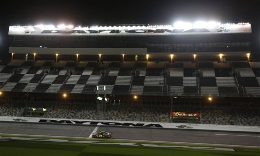 Jeff Gordon drives through the front stretch under the lights during practice for the NASCAR Sprint Unlimited Shootout auto race at Daytona International Speedway, Friday, Feb. 15, 2013, in Daytona Beach, Fla. (AP Photo/John Raoux)
