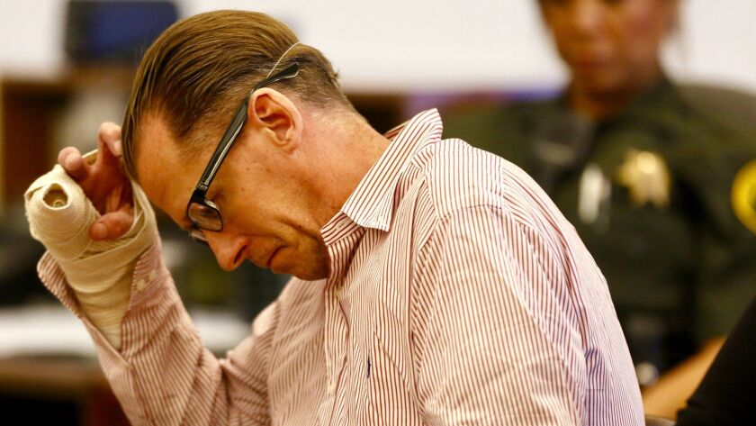 Steven Dean Gordon sits with his head down during sentencing proceedings in a Santa Ana courtroom Friday.