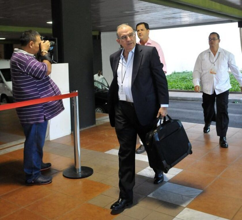 Colombia's chief negotiator arrives for peace talks with FARC.