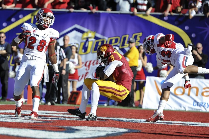Southern California wide receiver Marqise Lee, here catching a TD pass in the Royal Purple Bowl, is a draft prospect Chargers fans are interested in. (AP Photo/David Cleveland)