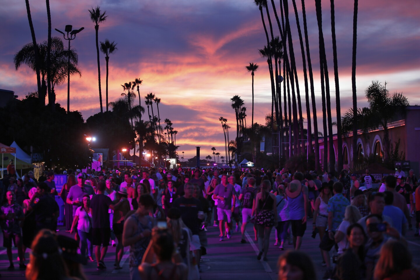 Fans walk through KAABOO Del Mar at sunset on Sept. 15, 2019.