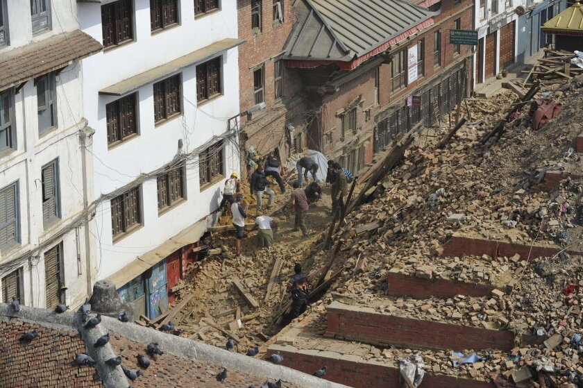 People search through the rubble at the earthquake-damaged Durbar Square in Katmandu, Nepal's capital, on April 28.