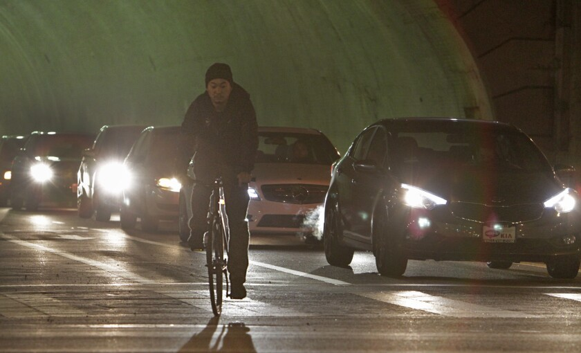 A cyclist in the bike lane coming out of the 2nd Street tunnel in downtown Los Angeles.