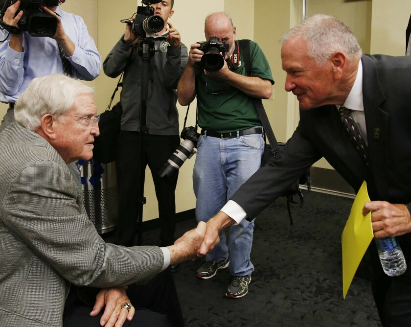 Baylor interim head football coach Jim Grobe, right, shakes hands with Grant Teaff following a news conference, Friday, June 3, 2016, in Waco, Texas. Teaff asked Grobe to come to Baylor after former head coach Art Briles was fired last week. (Rod Aydelotte/Waco Tribune Herald, via AP) /Waco Tribune
