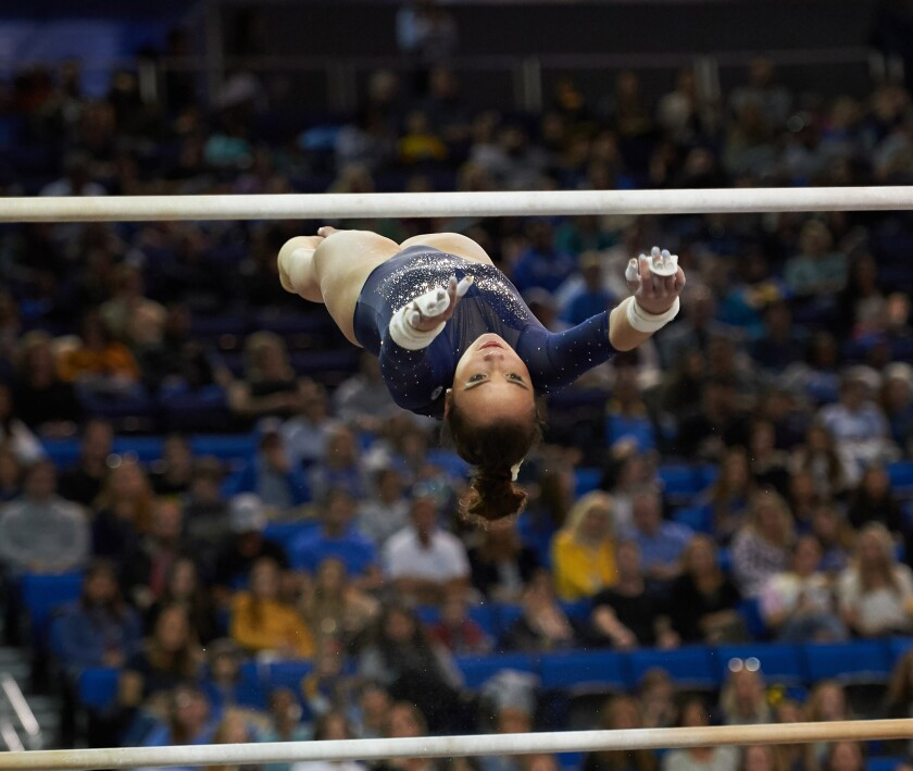 UCLA gymnast Kalyany Steele competes on the uneven bars during the 2020 season.