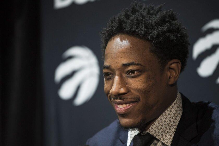 Toronto Raptors NBA basketball player DeMar DeRozan speaks to media during a press conference in Toronto, Thursday, July 14, 2016. (Aaron Vincent Elkaim/The Canadian Press via AP)