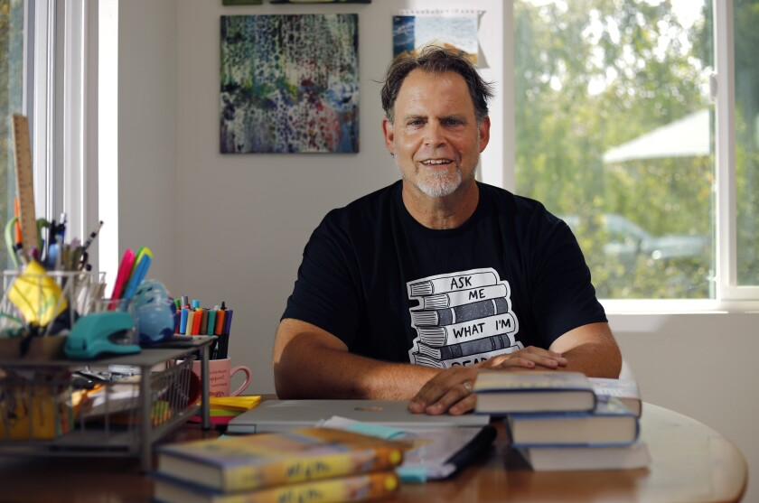San Diego author Chris Baron is photographed at his home office in La Mesa.