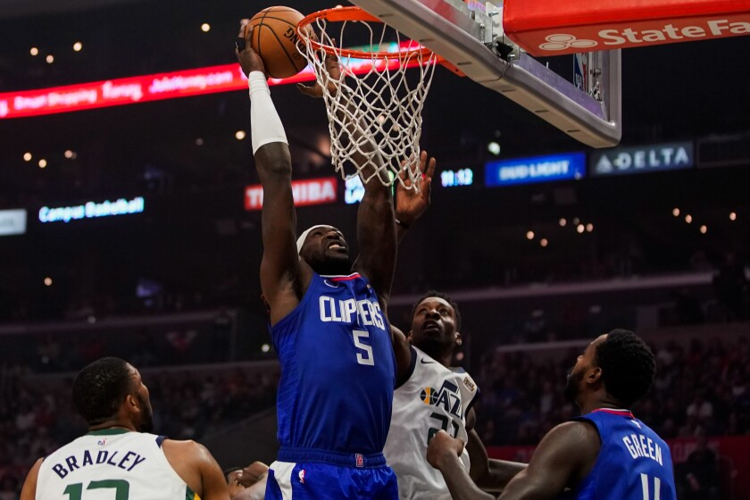 Clippers forward Montrezl Harrell puts up a shot during a 105-94 victory over the Utah Jazz at Staples Center on Sunday.