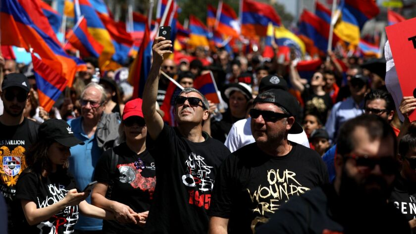 Activists in L.A. march on a day of remembrance of the Armenian genocide