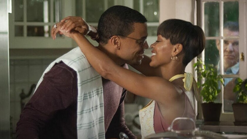 "Michael Ealy and Meagan Good, with Dennis Quaid peering through the window, in ""The Intruder."""