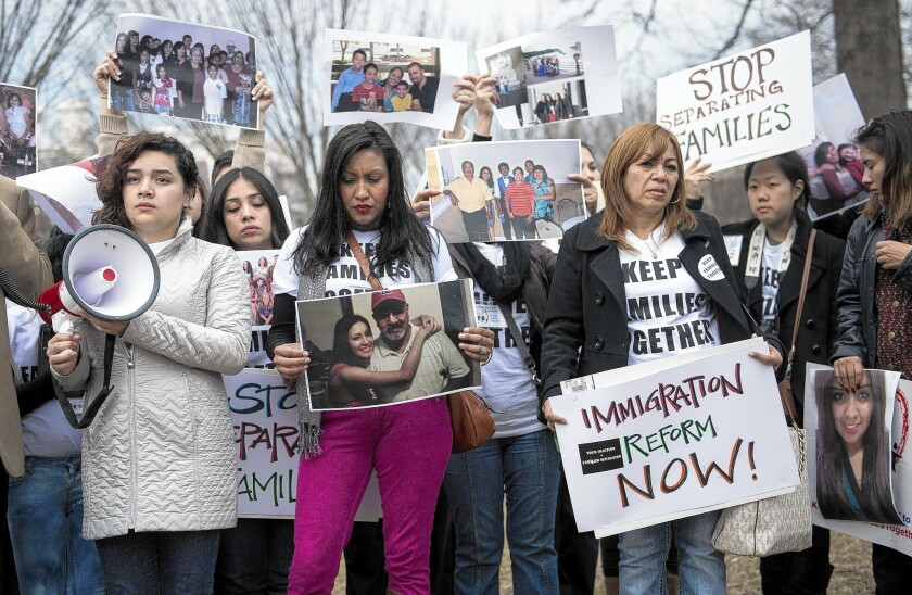 "Activists gather outside the White House to protest deportations. President Obama has called on the Department of Homeland Security to enforce immigration laws ""more humanely."""