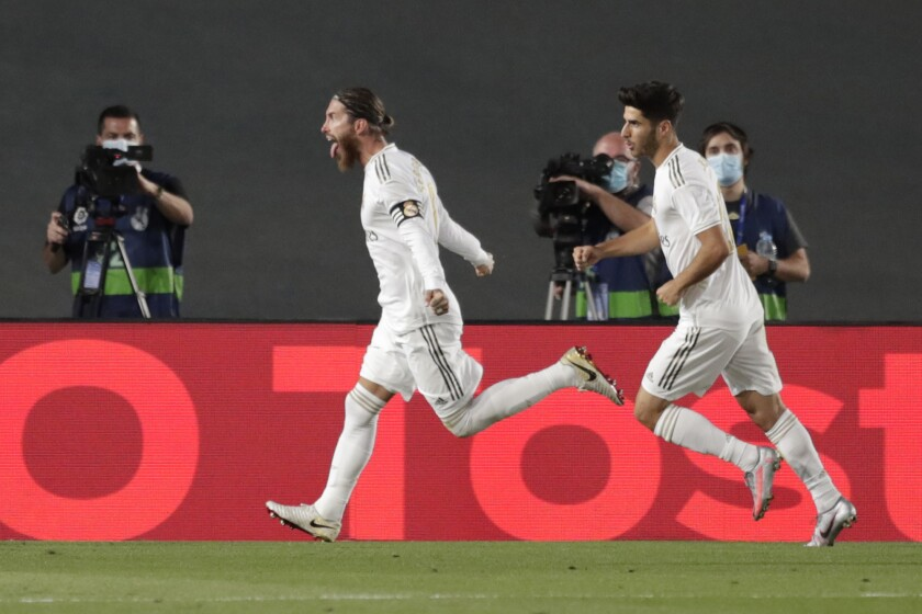 Real Madrid's Sergio Ramos, left, celebrates after scoring the opening goal against Getafe in Madrid on July 2.