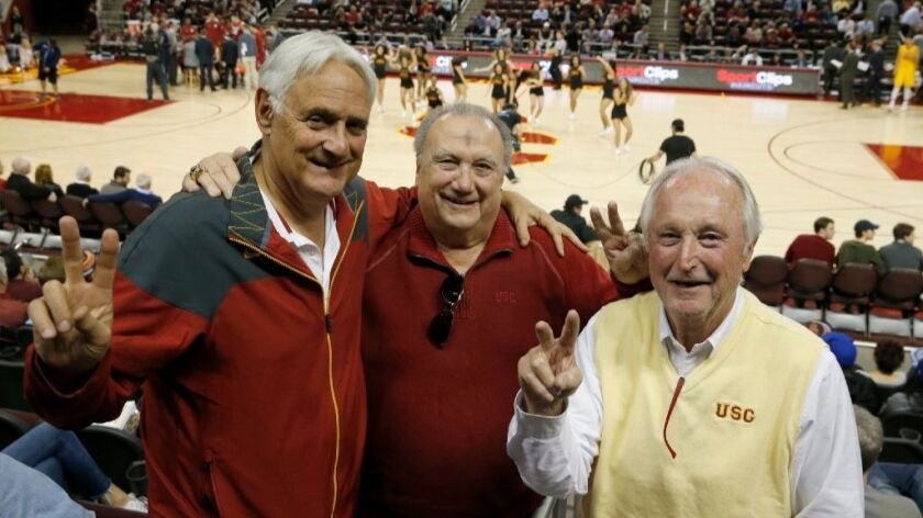 From left: John Colich, Ron Laraneta and Fred Crook, members of the Road Warrior group who passionately follow USC to away games, attend the Trojans' home game against Washington State on March 1.