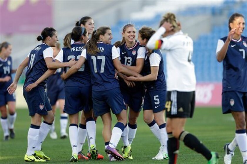 Alex Morgan, 4rd right, of the US, celebrates after scoring the opening goal against Germany during their Algarve Cup women's soccer final match Wednesday, March 13 2013, at the Algarve stadium outside Faro, southern Portugal. The US defeated Germany 2-0 in the final. (AP Photo/Armando Franca)