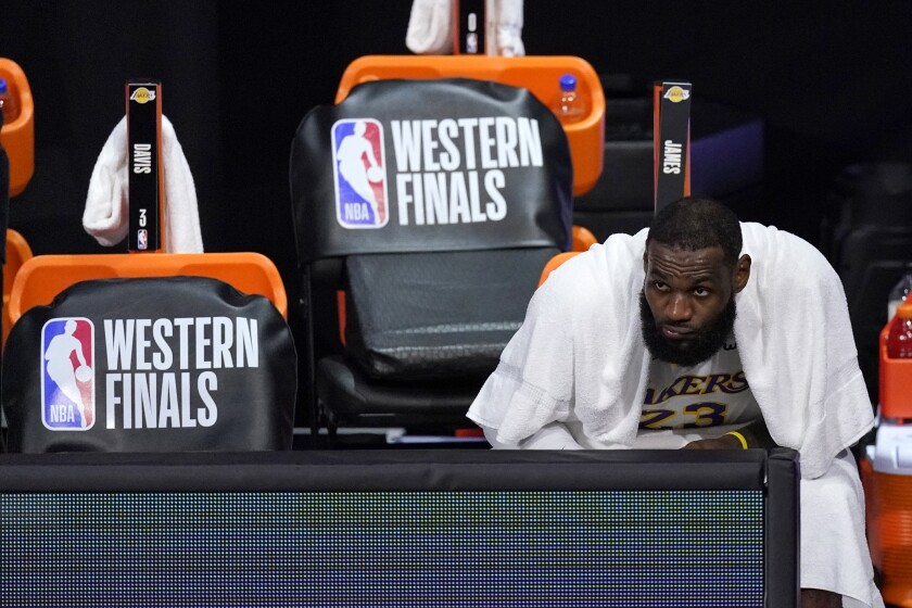 Lakers forward LeBron James watches play against the Denver Nuggets.