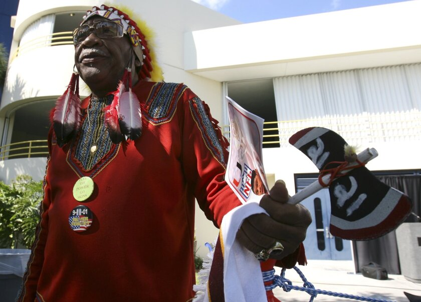 FILE - In this Dec. 3, 2007, file photo, Washington Redskins football fan Zema Williams stands outside of the funeral for Washington Redskins safety Sean Taylor at the Pharmed Arena at Florida International University in Miami. The team announced Tuesday, July 19, 2016, that Williams died the day b