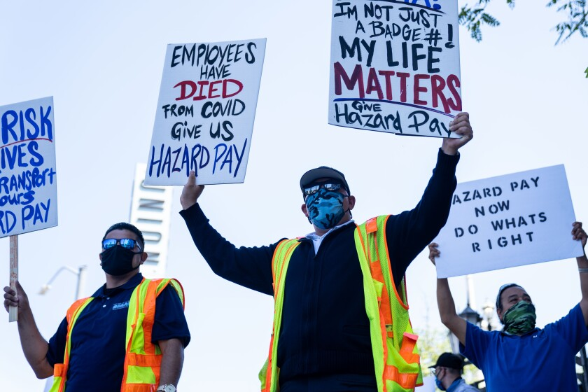 Metro bus drivers protest in downtown Los Angeles demanding hazard pay for working during the COVID-19 pandemic.