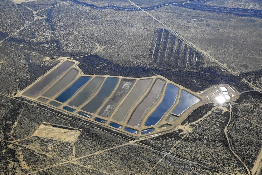 Pits contain production water from oil wells in Kern County.