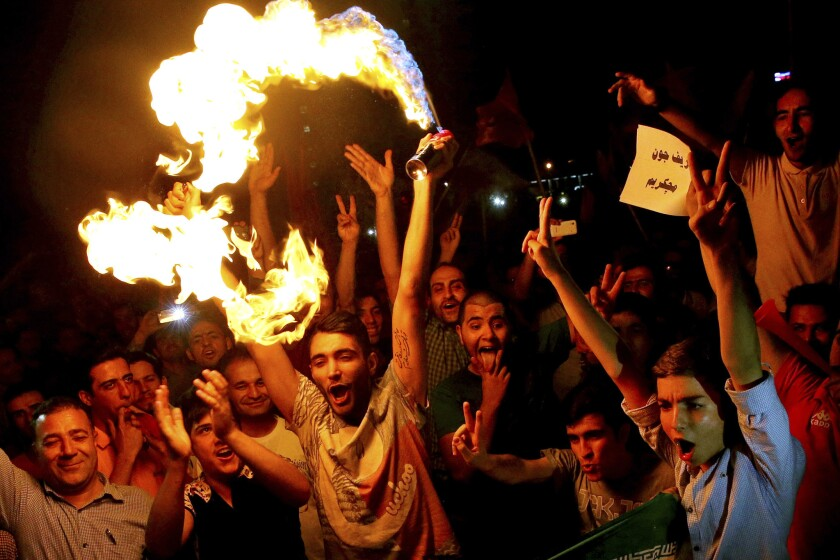 Iranians celebrate in Tehran after the landmark nuclear deal was announced July 14.