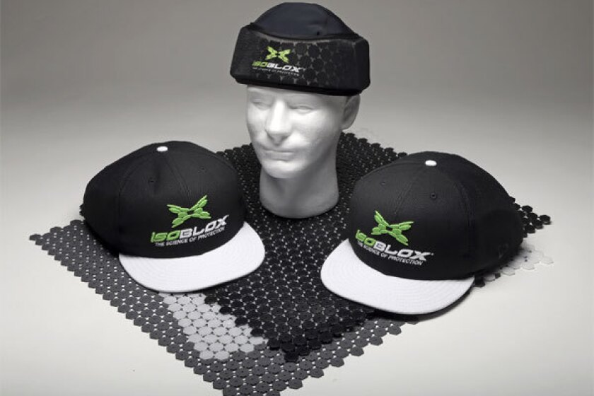 The new IsoBLOX protective caps for baseball players include full-size caps and a youth-level protective skull cap for under a standard fielder's cap.
