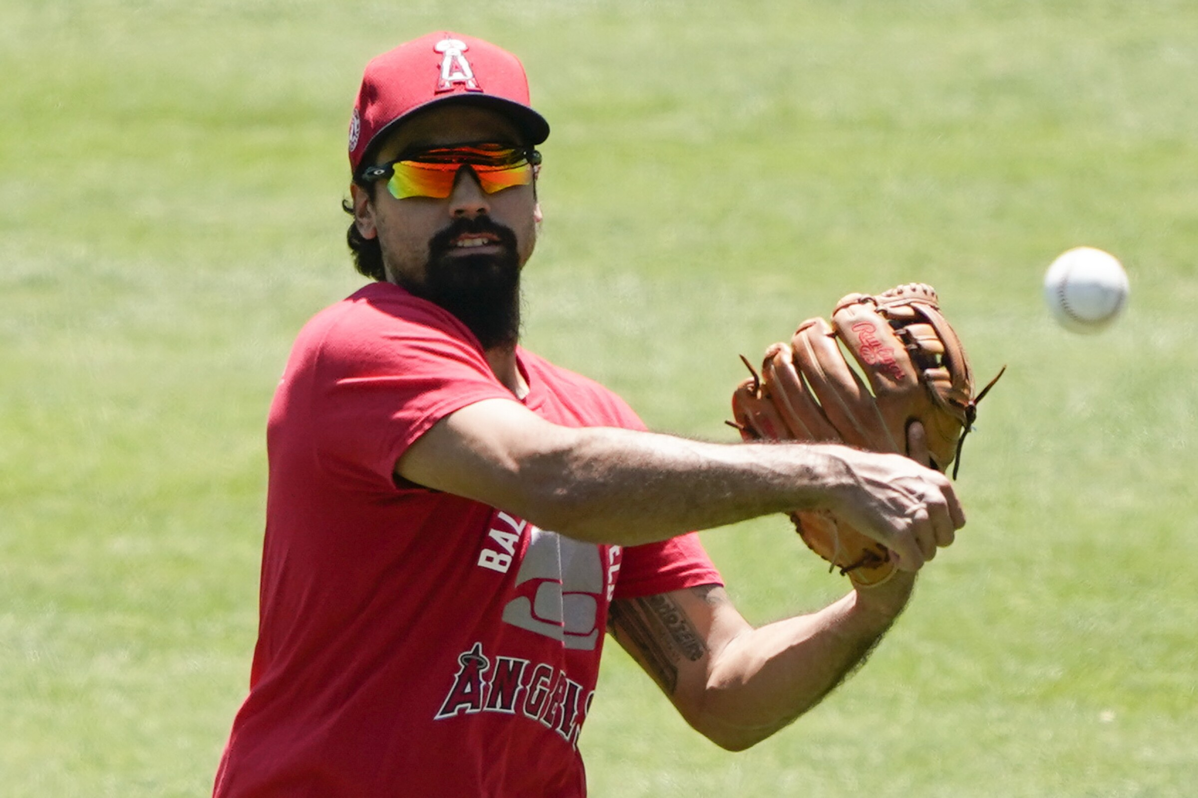 Los Angeles Angels third baseman Anthony Rendon throws during practice.