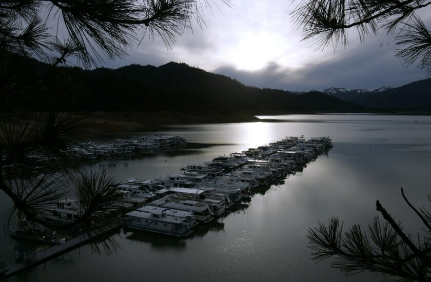 FILE - In this Feb. 22, 2008, file photo, boats are seen docked on Lake Shasta, Calif. The National Forest Service says workers cleaned up half-mile wide swath of trash on May 25, 2016, left behind by about 1,000 campers following an annual trip to the lake by fraternity and sorority members last w