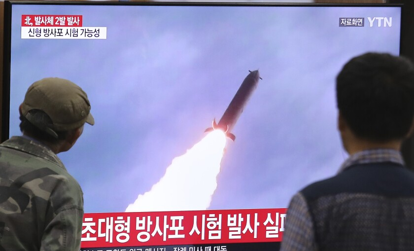 People watch a TV showing a file image of an unspecified North Korea's missile launch during a news program at the Seoul Railway Station on Thursday.