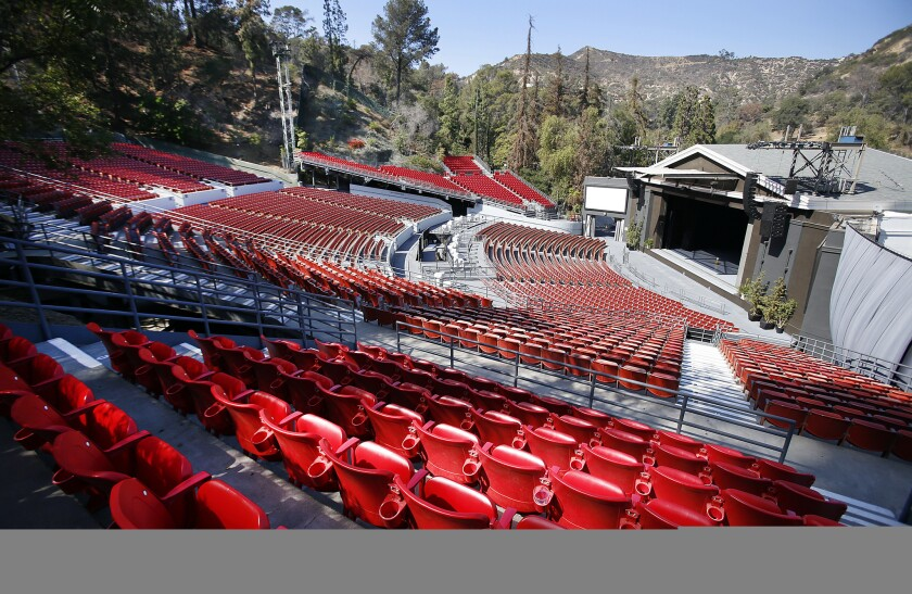 The iconic Greek Theatre in Griffith Park is among the venues that will be controlled by a new entity created by the merger of AEG Facilities and SMG.