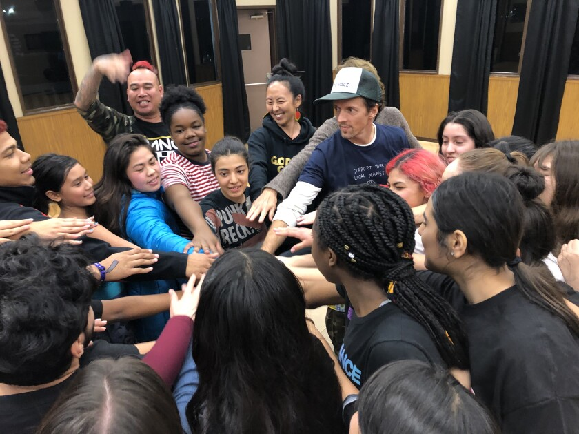 Jason Mraz (center right) with young performers from the San Diego troupe transcenDANCE.