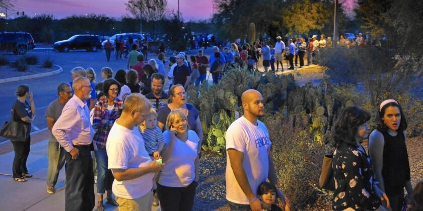 Residents wait to vote in Chandler, Ariz.