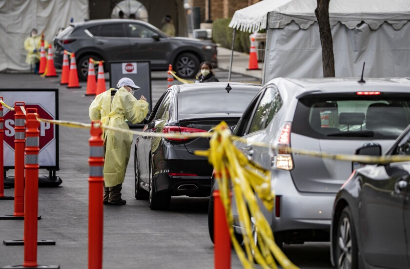 Drivers wait in line at a drive-through coronavirus testing place at St. Jude Heritage Medical Group on March 19 in Yorba Linda.