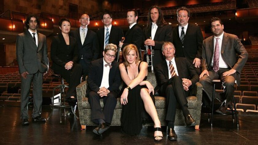 The band Pink Martini is shown not long after Storm Large (center, in black gown) became a member.