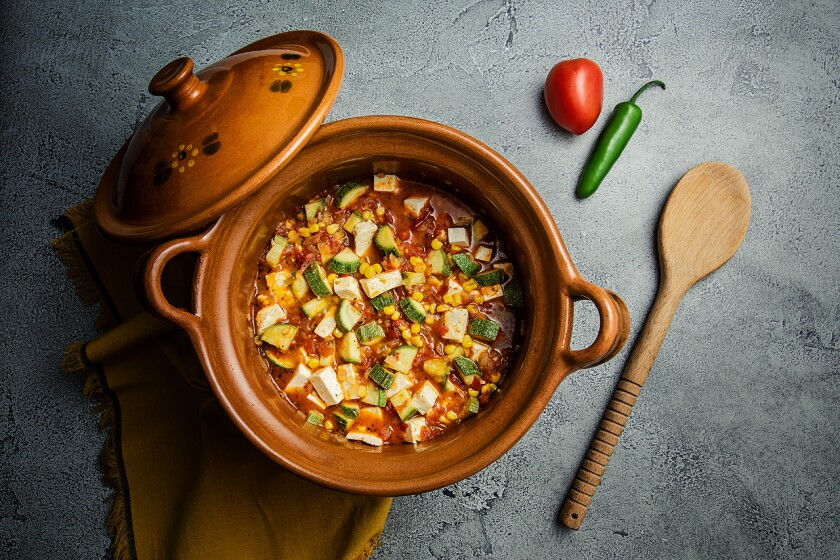 This Mexican stew is made with tomatoes, onions, garlic, Mexican squash, corn and Mexican farmer's cheese.