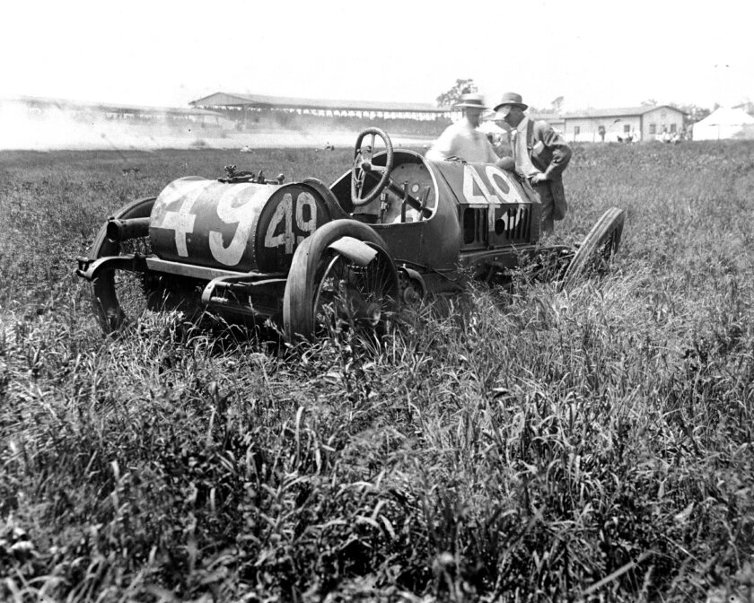 In this May 30, 1914, photo provided by Indianapolis Motor Speedway, the wrecked car of Ray Gihooley sits on the grass near turn 2  during the fourth running of the Indianapolis 500 auto race at Indianapolis Speedway in Indianapolis, Ind.  (IMS via AP)