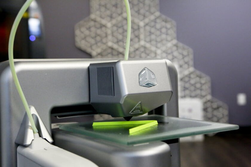 A 3-D printer replicates a plastic form at a 3D Systems Inc. lab in Valencia.
